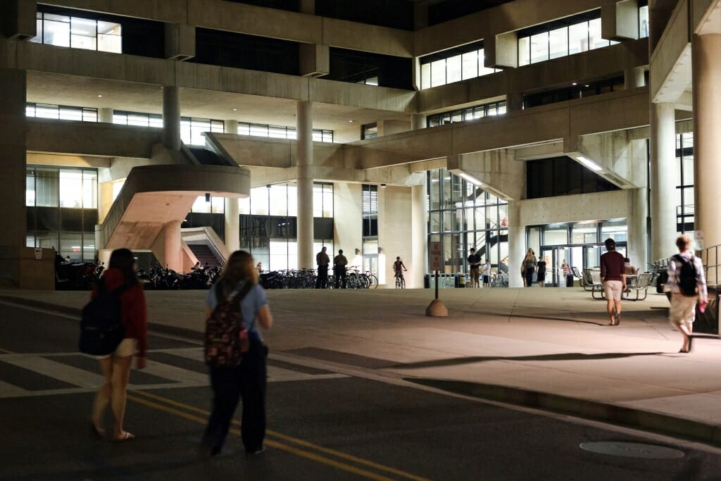Photo: Pedestrians cross Observatory drive as they walk toward College Library in Helen C. White Hall.