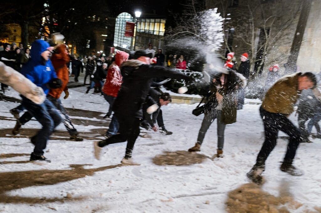 Photo of students pelting each other with snowballs.