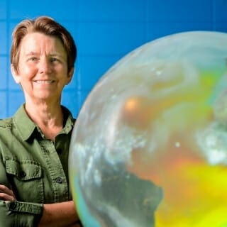 "<strong>Margaret E. Mooney</strong><br><i>Director of Education and Public Engagement, Cooperative Institute for Meteorological Satellite Studies, Space Science and Engineering Center</i><br>Robert and Carroll Heideman Award for Excellence in Public Service and Outreach<br><br>When the latest cutting-edge weather satellites were launched from Kennedy Space Center in 2016 and again this March, Margaret Mooney was there, accompanied by science teachers from across the country. <br><br> UW–Madison scientists played an integral role in developing the missions for both satellites; Mooney proposed and led the creation of related lesson plans for middle and high schools nationwide. It's just one example of the endlessly innovative work Mooney (pictured with an interactive globe) undertakes in her education and outreach role with the Space Science and Engineering Center. She has co-developed and co-taught an online course on climate change with more than 7,000 participants, modernized a summer science camp for high school students, and guided thousands of Wisconsin schoolchildren on educational tours of the center.  <br><br> ""Ms. Mooney is truly motivated and inspired by the Wisconsin Idea,"" says Steven Ackerman, interim director of the center and associate vice chancellor for research. ""Through her dedication and hard work, she has achieved a national reputation of excellence in education and outreach and is an outstanding representative of the values of UW–Madison."" Mooney's goal is to spark student and public interest in STEM fields: science, technology, engineering and math. Mission accomplished, her colleagues say."
