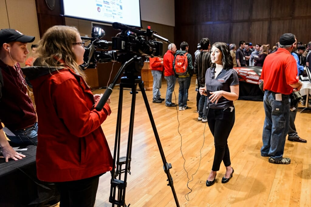 UW-Madison Badgerloop president Kali Kinziger, a senior majoring in communications, speaks with members of the media at the unveiling.