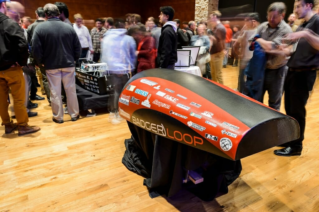 The carbon-fiber cover of Badgerloop Pod III, shown at the public unveiling. This year's competition requires use of an entirely self-propelled pod.