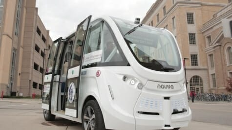 Photo: Driverless vehicle in front of parking garage