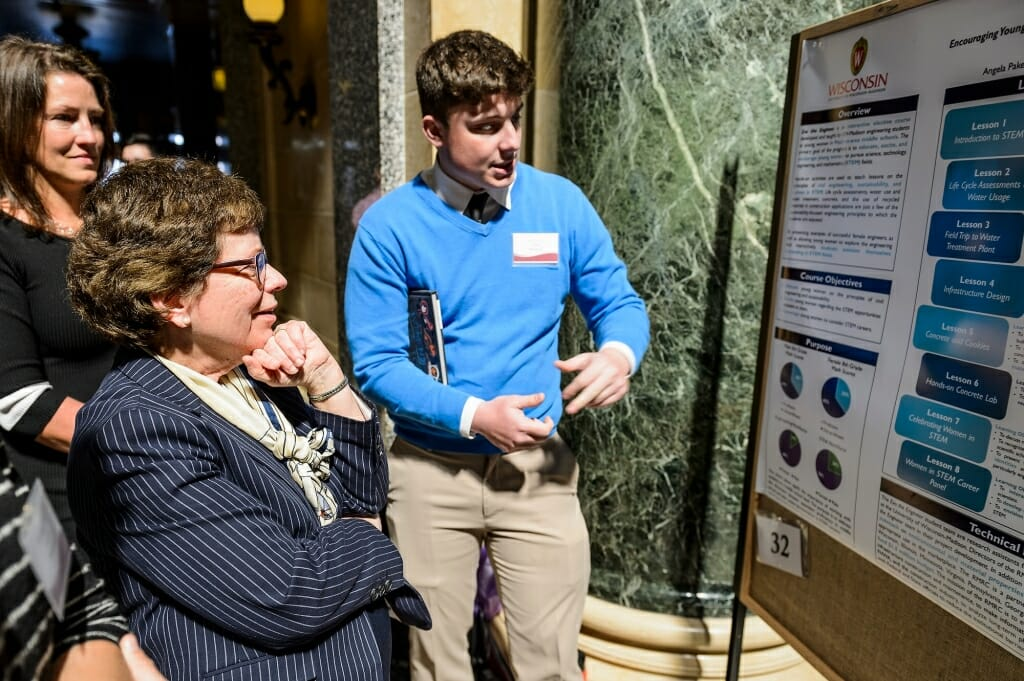 UW-Madison Chancellor Rebecca Blank asks questions of student Tyler Klink about he and his teammates' research project.