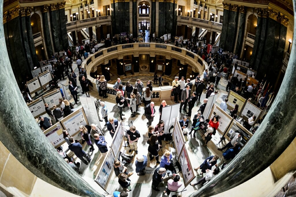 UW-Madison students present their research project displays as people fill the Wisconsin State Capitol during Research in the Rotunda.
