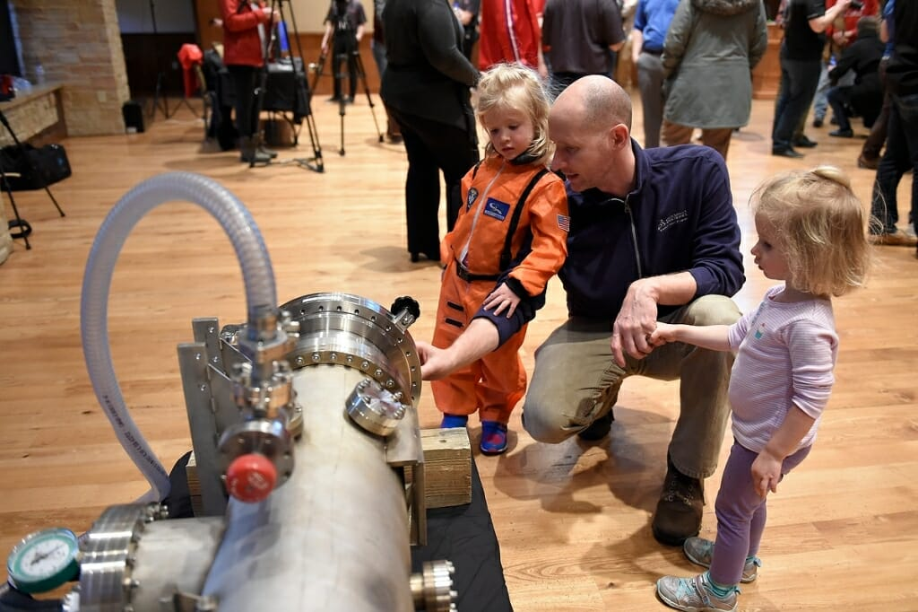 Future astronaut Madeline Stendel checks out the hardware at the Badgerloop Pod III reveal on Thursday at Varsity Hall in Union South. Badgerloop Pod III — its latest entry into the 2018 SpaceX Hyperloop Competition, an event designed to spur new ideas about an ultrafast, futuristic form of transportation.