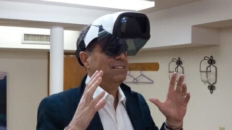 Testing some virtual-reality goggles is just another workday for Madison innovation specialist and UW-Madison grad Bruce Winkler.
