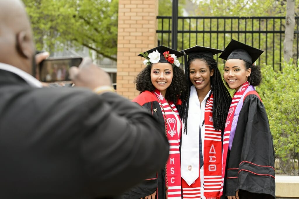 Photo of Alexandra Adams, Akilah Davis and Samantha Adams taking a group photo.