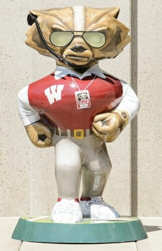 Photo of Bucky Badger statue modeled after UW Athletic Director Barry Alvarez, complete with headset and sunglasses.