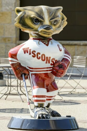 Photo of Bucky Badger as a hockey player in Wisconsin uniform.