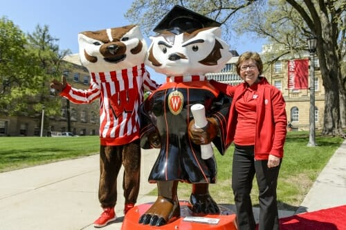 """Photo of Bucky and Chancellor Blank posing with """"Graduation Bucky,"""" one of 85 life-sized statues across Dane County."""