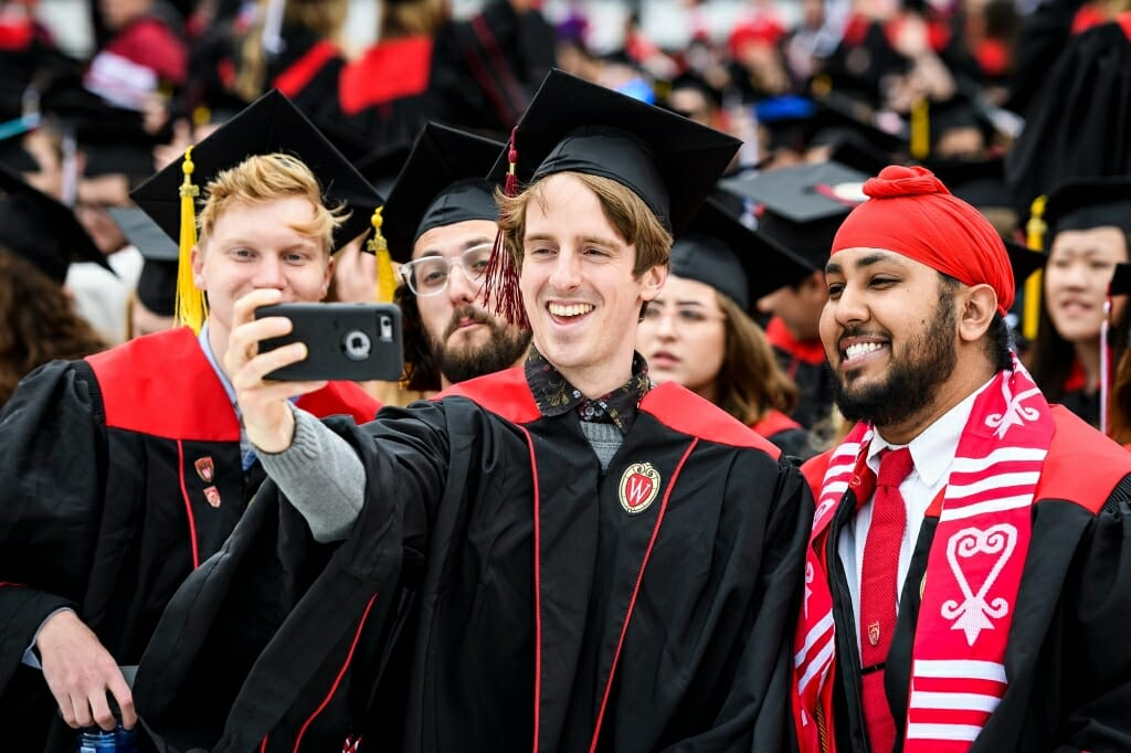 Photo of, from left to right, College of Letters and Science graduates Joseph Hushek, Roger Daley, Keegan Hasbrook and Jasdeep Kler posing for a selfie.
