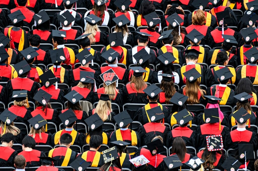 Photo of rows of seated graduates.