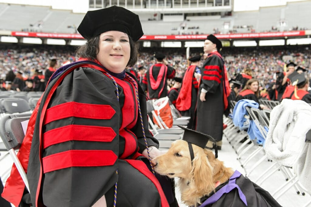 Photo of Sara Conrad and her dog, Renee, sharing a moment.