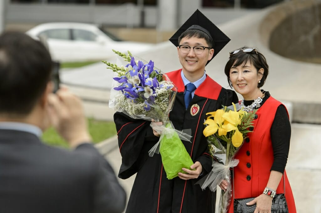Photo of graduate David Kim posing with his mother.