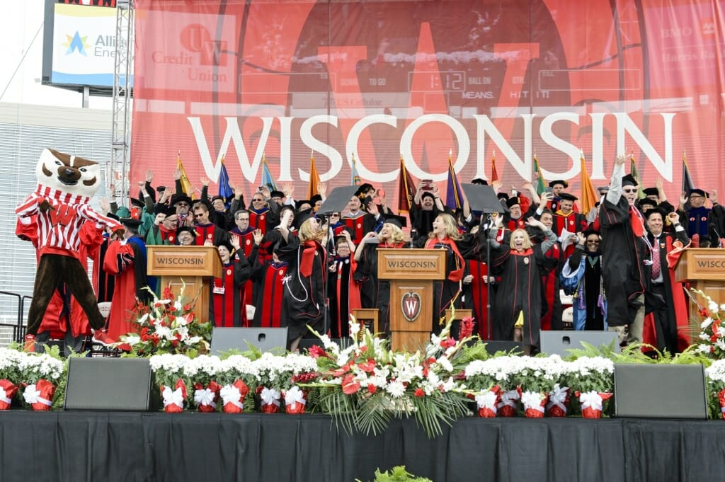 Photo of the entire platform party and Bucky Badger jumping around.