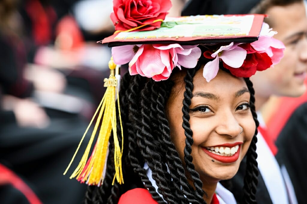 Photo of Arissa Milton, graduating with bachelor's degrees in neurobiology and psychology, who decked her mortarboard in flowers.