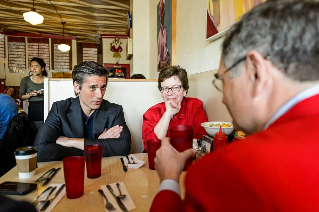 Photo of Muir enjoying breakfast with Chancellor Rebecca Blank and her husband, Hanns Kuttner, at Mickies Dairy Bar, a classic Madison diner near Camp Randall.