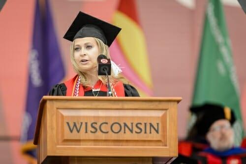 Photo of Ariela Rivkin, senior class president, addressing the graduates.