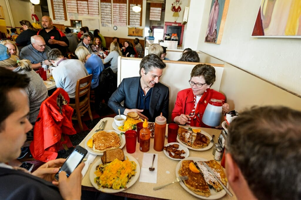 Photo of Muir, Blank and Kuttner with a table full of pancakes.