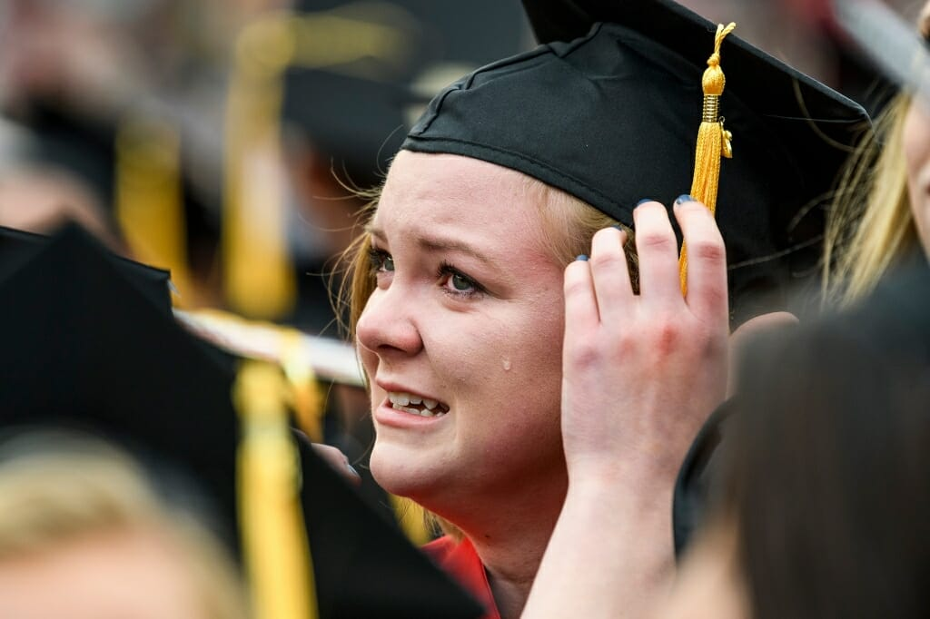 Photo of Jessica Kreuser, graduating with a bachelor's of science in nutritional sciences, shedding a tear at the ceremony's end.