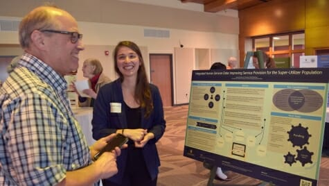 A student explains her project to a UniverCity Year celebration attendee
