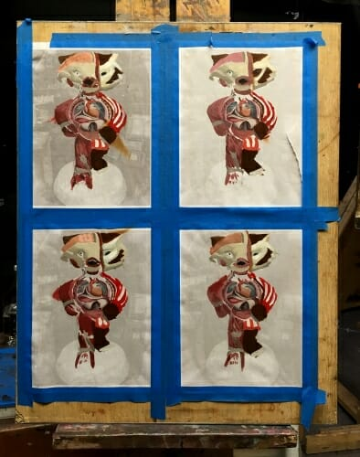 A photo of reference paintings done by Philip Salamone before he embarked on painting his 6-foot-tall Bucky statue.