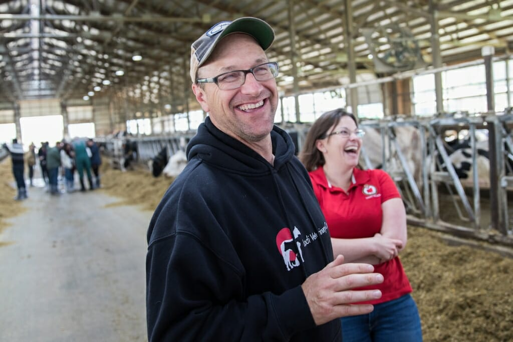 Photo: Mitch Breunig smiling in cow barn