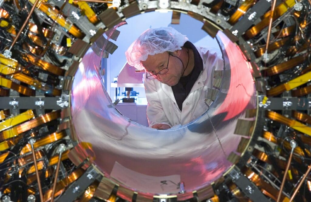 Photo: Worker seen through a semiconductor barrell