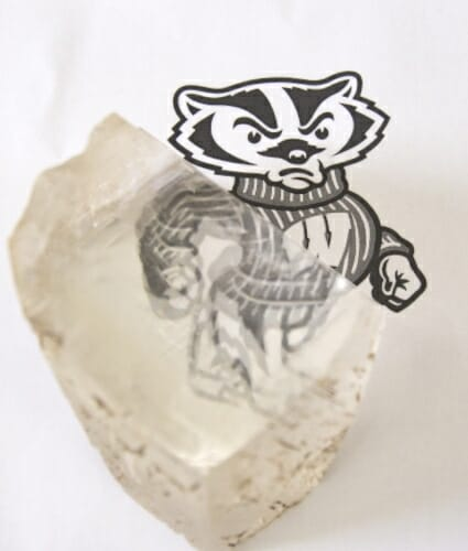 Photo: Double-image of Bucky Badger picture shown through calciite