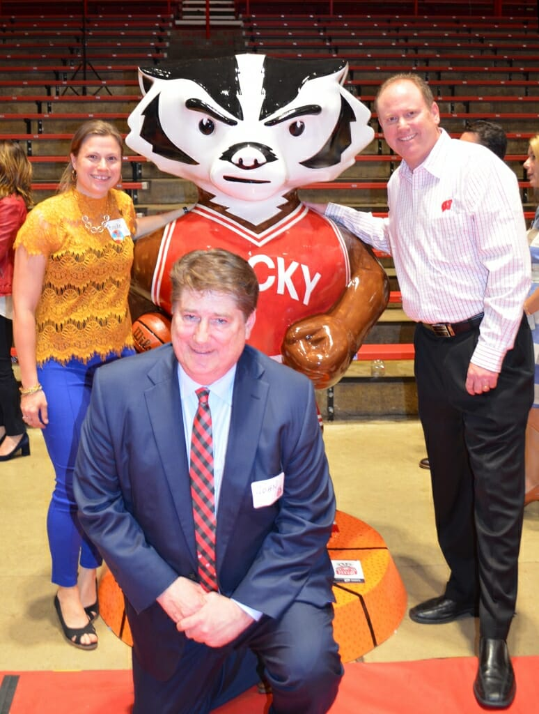 Wentland, Sheehan and Coach Greg Gard, whose charity Garding Against Cancer will receive proceeds from the sales of Bucky on Parade statues, stand next to Baller Bucky at an unveiling event at the Field House.