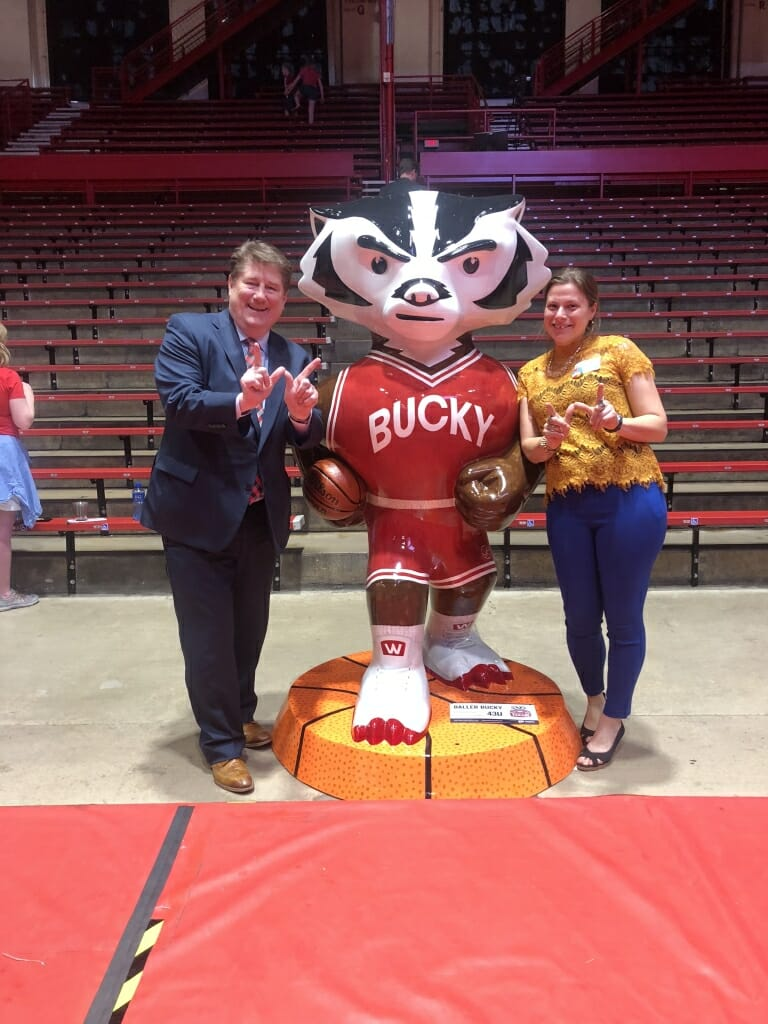 Artist Brooke Wentland and John Sheehan, who sponsored the Bucky, stand next to Baller Bucky at an unveiling event at the Field House.
