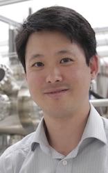 Photo: Jason Kawasaki standing in lab