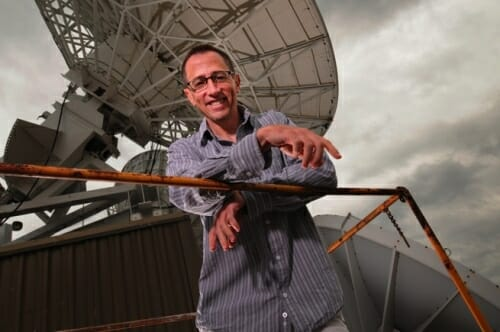 Photo: Jim Kossin on rooftop next to satellite dish