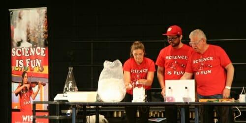 Photo: Three presenters looking at packing peanuts
