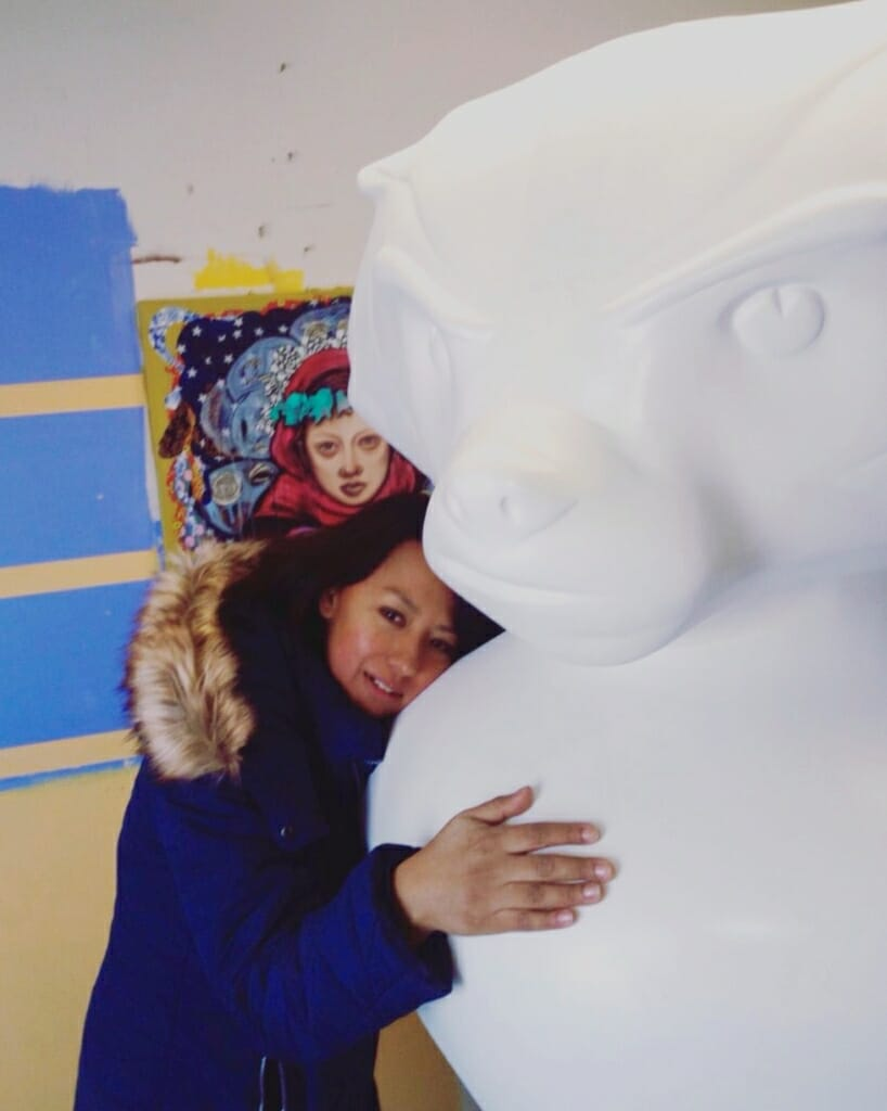 Contreras hugs her blank, 6-foot tall Bucky Badger statue before its transformation into Goodnight Bucky.