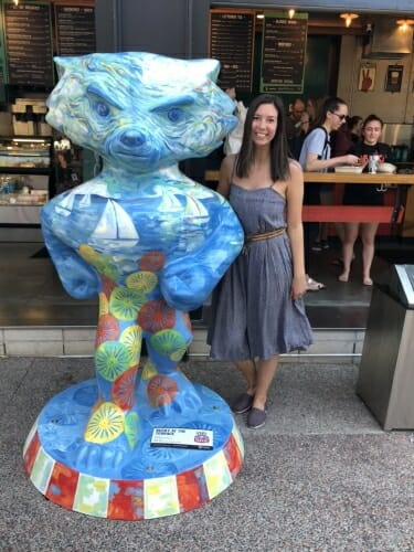 Artist Nicole Rosenbaum stands next to the Bucky she designed, Terrace Bucky, outside of Collectivo Coffee.