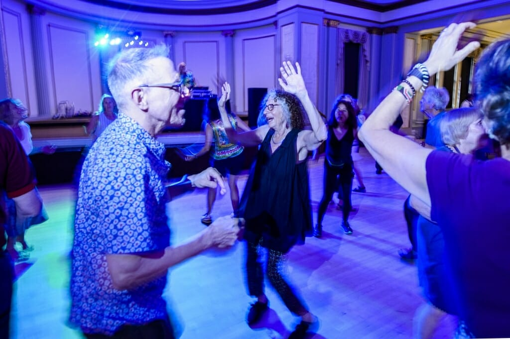 UW alums Andy Mirer (left) and Suzanne Korey (center) take to the dance floor during the Dance Party event in the Great Hall in the Memorial Union at the University of Wisconsin–Madison, which was part of the larger Madison Reunion that took place from June 14-17, 2018.
