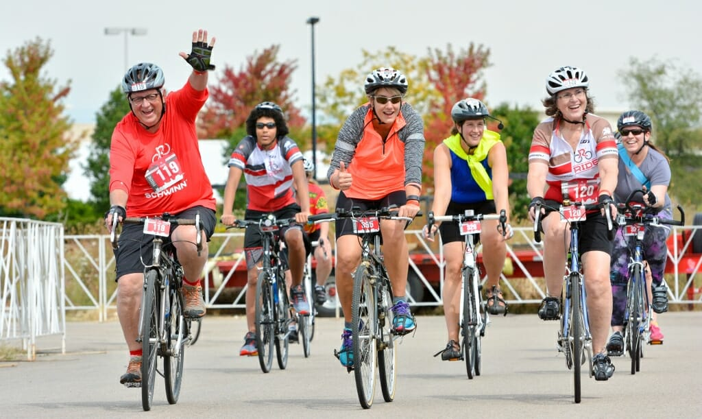 Photo: Six bicyclists crossing finish line