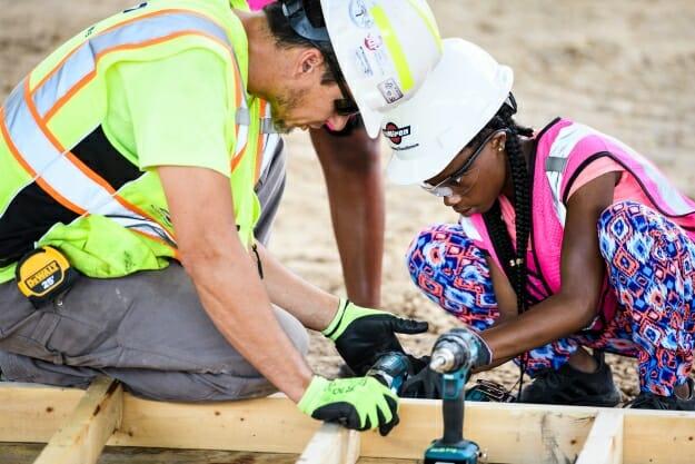 Armani-Raven Nichols, right, learns carpentry skills.