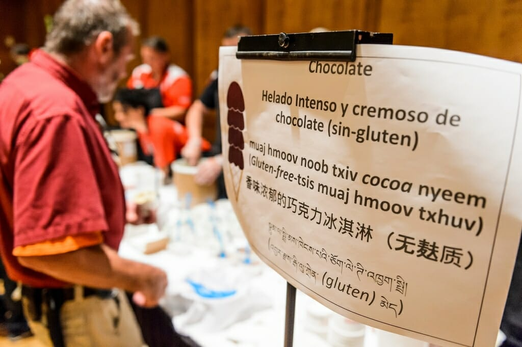 Photo: Sign for chocolate ice cream translated into several languages