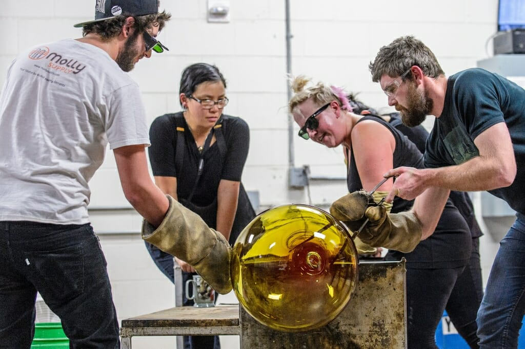 Photo: Students around molten glass project