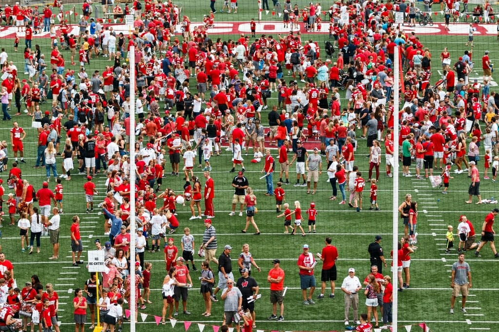 Badger fans dot the field during Football Family Fun Day.