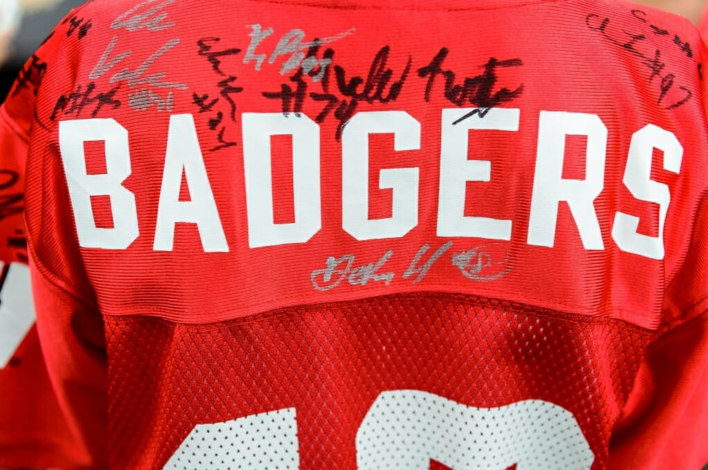 Player signatures adorn a young fan's jersey.