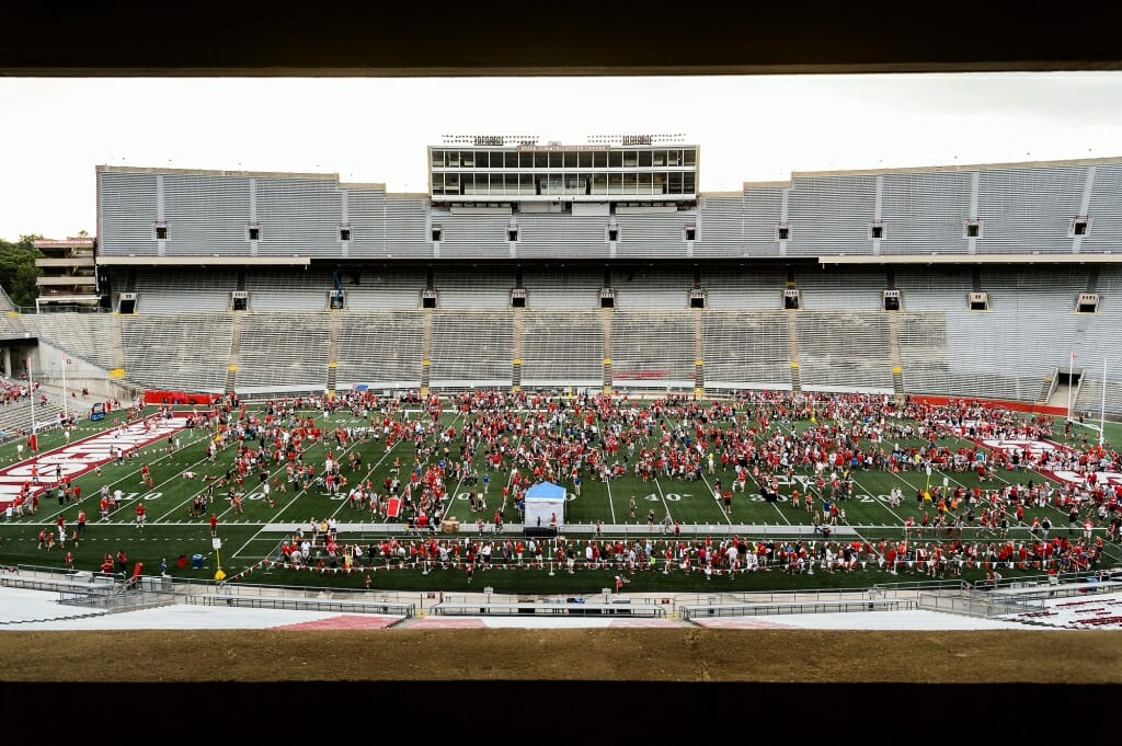 Badger fans dot the field during Football Family Fun Day at Camp Randall Stadium on Aug. 1.
