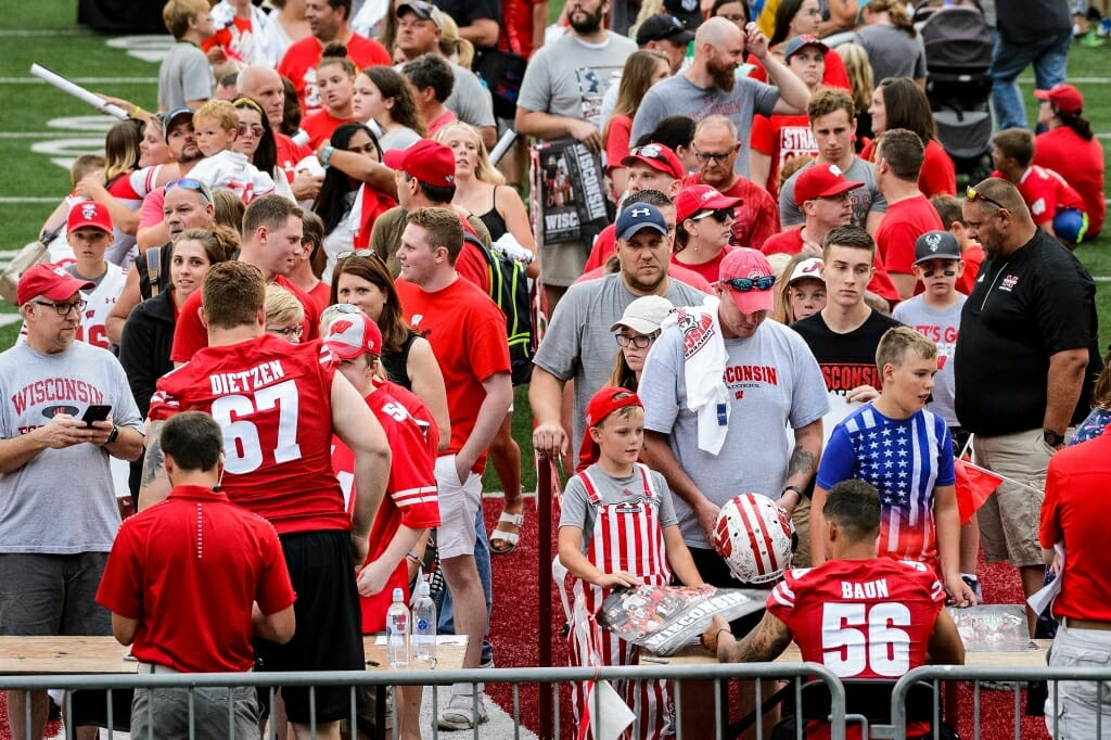 Badger fans line up to collect autographs  from a number of varsity Wisconsin football players.