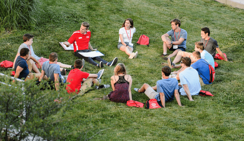 New-student leader Jack Lindenberg, left of center, talks with incoming first-year undergraduates and facilitates a small-group discussion about the challenges new students may face as they transition to campus life during in a Student Orientation, Advising and Registration (SOAR) session.