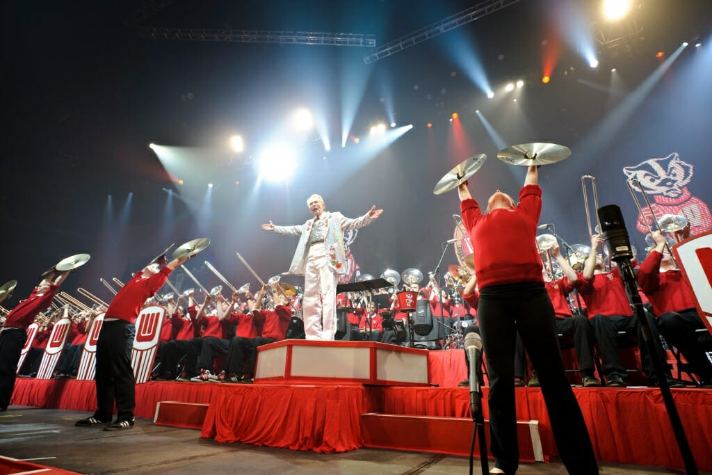 Photo: Leckrone conducting with band members behind him