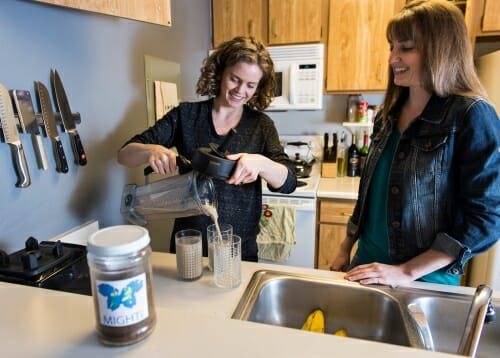 Photo: Bergmans and Stull in a kitchen putting mealworms into a blender