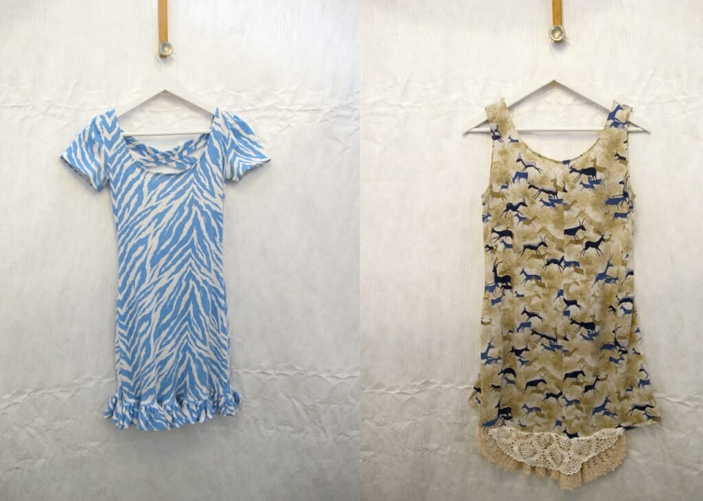 Two dresses designed by Emily Popp. One is a blue and white striped print dress and the other is a beige dress that features the silhouettes of deer.