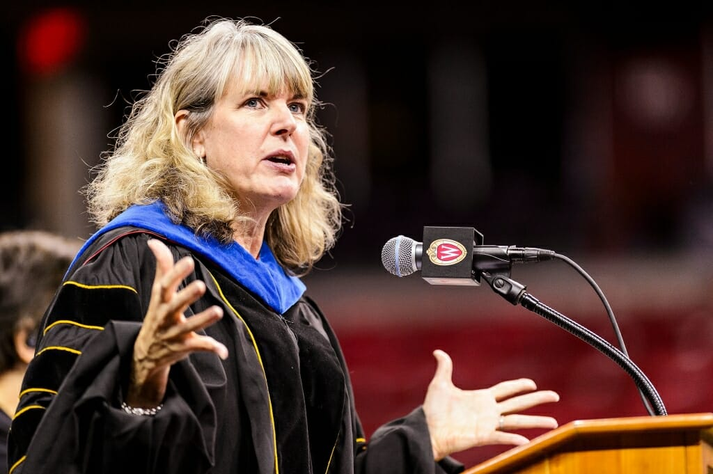 Lori Reesor, vice chancellor of student affairs, speaks at the ceremony.